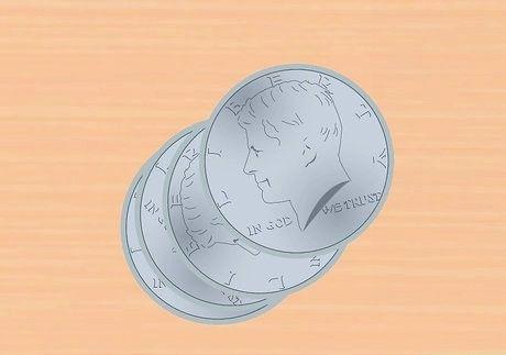 जंक सिल्वर सिक्के के मूल्य की गणना कैसे करें